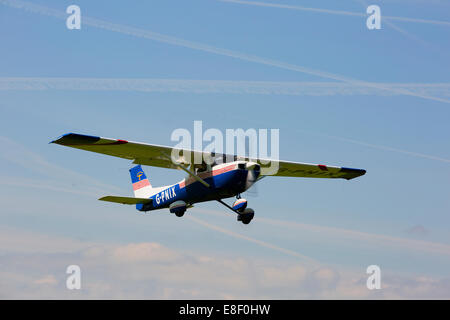 Reims Cessna FRA150L G-PNIX in flight Taking-off from Netherthorpe Airfield - Stock Photo