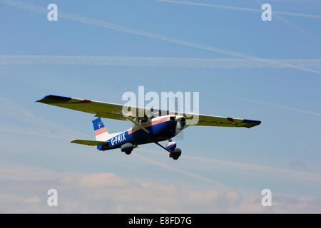 Reims Cessna FRA15oL G-PNIX in flight taking-off from Netherthorpe Airfield - Stock Photo