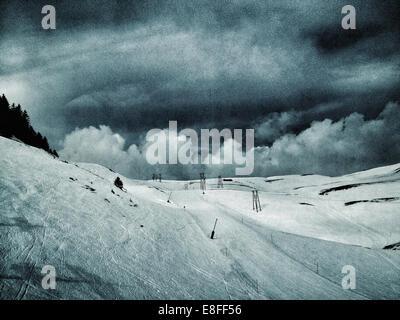 Ski slope in the mountains - Stock Photo
