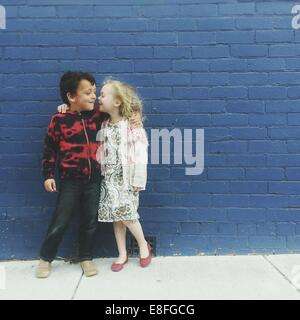 Boy and girl with their arms around each other - Stock Photo