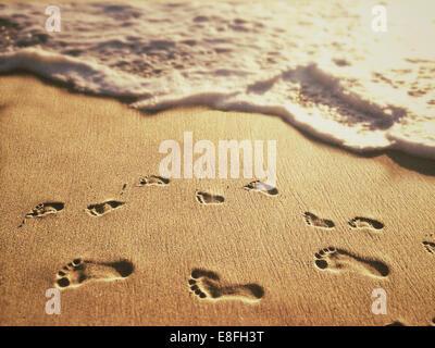 USA, California, Orange, Laguna Beach, Footprints on sand - Stock Photo