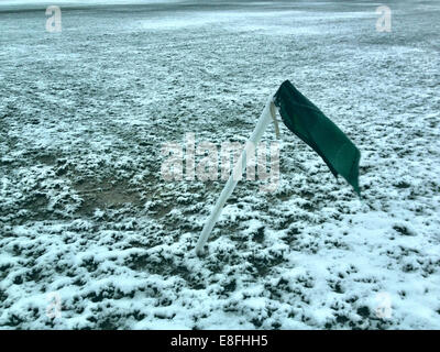 UK, London, London Borough of Haringey, Highgate Village, Football corner flag on snow covered pitch - Stock Photo