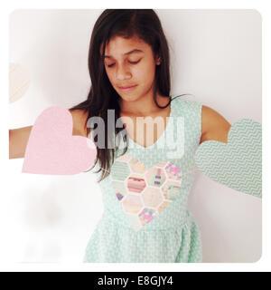Girl holding heart shape banner - Stock Photo