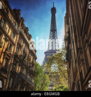 France, Paris, Eiffel Tower seen in between townhouses - Stock Photo