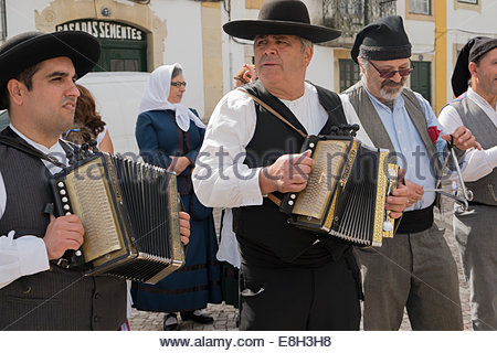 Men dressed in traditional clothing performing at a street market in Tomar Portugal held 5th October to celebrate - Stock Photo