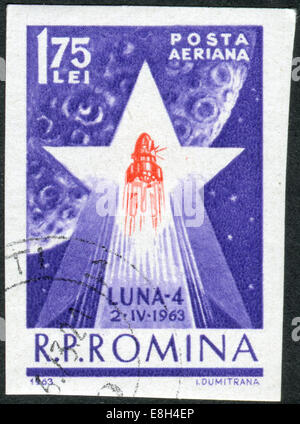 ROMANIA - CIRCA 1963: Postage stamp printed in Romania shows 'Luna 4' rocket inside a star before the moon, circa - Stock Photo