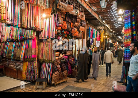 Horizontal view of people walking through the souks of Marrakech. - Stock Photo