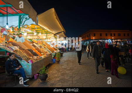 Horizontal view of the busy temporary food stalls set up in Place Jemaa el Fna (Djemaa el Fnaa) in Marrakech at - Stock Photo