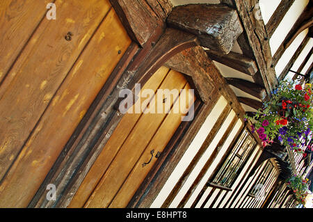 These medieval timber buildings form part of the old almshouses adjacent to King Edward Seventh grammar school in - Stock Photo