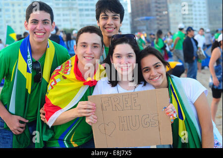 Rio de Janeiro. World Youth Day 2013. Pilgrims on Copacabana beach. Free hugs - Stock Photo