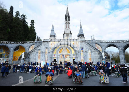 Gathering at Notre-Dame-du-Rosaire's basilica in the city of Lourdes. Yearly gathering of young christians, members - Stock Photo