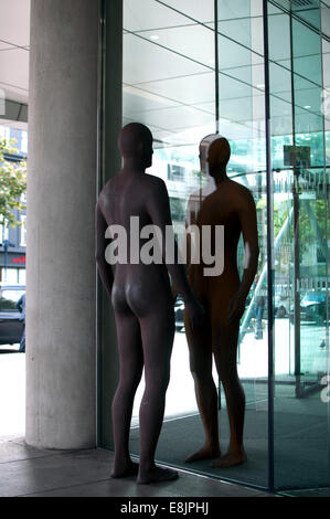Metal figures at 350 Euston Road building, Regent`s Place, London, UK - Stock Photo