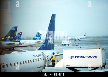 New York city NYC,  JFK Airport Jet Blue planes at terminal 5 get loaded with meals from Flying Foods - Stock Photo