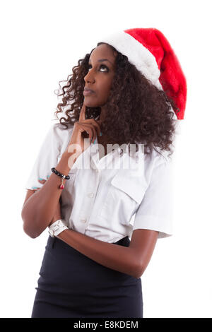 Young African American woman wearing a santa hat, isolated on white background - Stock Photo