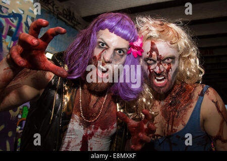 London, UK. 11 October 2014. Hundreds of scary Zombies gathered on World Zombie Day 2014 in the graffiti-covered - Stock Photo