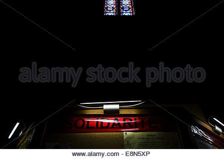 bulletin board in church, Perpignan, France. - Stock Photo