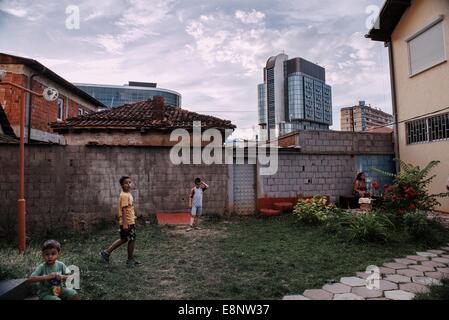 Children play at a backyard in the city of Pristina, Kosovo - Stock Photo