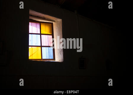 Coloured glass window with black background. - Stock Photo