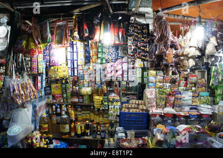street market stall selling groceries and sundry items in Ho Chi Minh city - Stock Photo