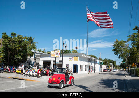 Tourists in electric car in Key West, Florida - Stock Photo
