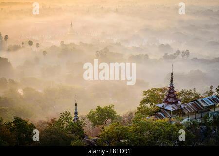 Fog over treetops, Mayanmar, Mandalay, Myanmar - Stock Photo