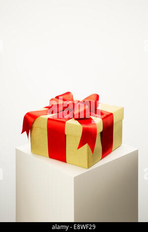 Close up of wrapped gift on pedestal - Stock Photo
