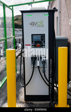 An electric car charging point in Tarbert on the Isle of Harris in the Outer Hebrides. - Stock Photo