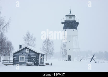 JAVRE, SWEDEN Lighthouse and traditional wooden structures - Stock Photo