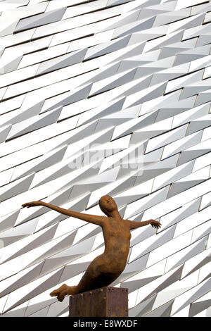 Bronze sculpture Titanica in front of the exterior of the Titanic building housing a museum to BelfastÆs maritime - Stock Photo