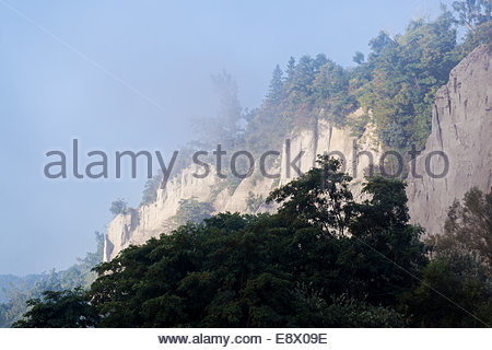 Scarborough Bluffs 300 foot high escarpment on a misty morning in Bluffer's Park beside Lake Ontario in Toronto - Stock Photo