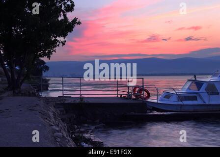 Sunrise on riverbank - Stock Photo