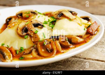 Sauerkraut Pierogi with Mushrooms and Tofu Pieces - Stock Photo