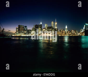 Lower Manhattan skyline and East river from Brooklyn at night prior to September 11 2001 New York City NY USA - Stock Photo