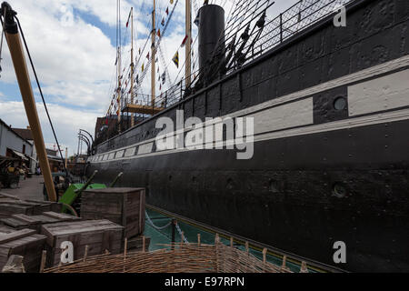 The SS Great Britain as seen from the quayside and showing the length of the hull. The ship was launched in 1843. - Stock Photo