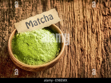 Matcha powder masde from ground green tea used as a traditional Japanese beverage and as a flavouring and colouring - Stock Photo