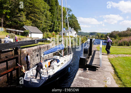 The Crinan Canal - A yacht negotiating Lock 7 at Cairnbaan, Argyll & Bute, Scotland UK - Stock Photo