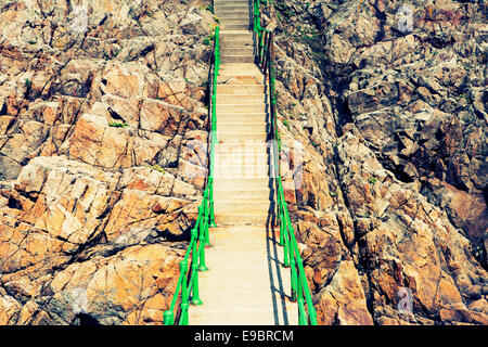 Stairs up a rocky path - Stock Photo