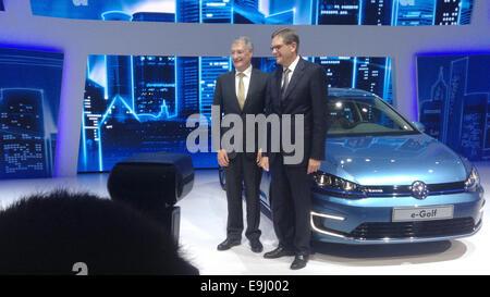 VWChina chief Jochem Heizmann (R) and VW development chairman Hans-Jakob Neusser explain the company's electric - Stock Photo