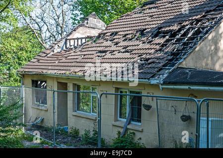 A fire damaged house - Stock Photo