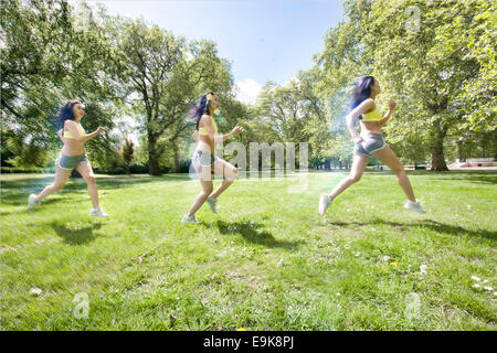 Multiple image of young fit woman jogging at park - Stock Photo