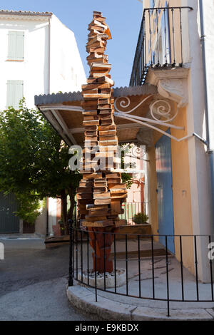 A stack of books as a sign, in front of 'the Cornflower' bookshop entrance, in Banon (France). Librairie les 'Bleuets', - Stock Photo