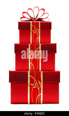 Stacked red Christmas gift boxes with ribbon and bow isolated on white - Stock Photo