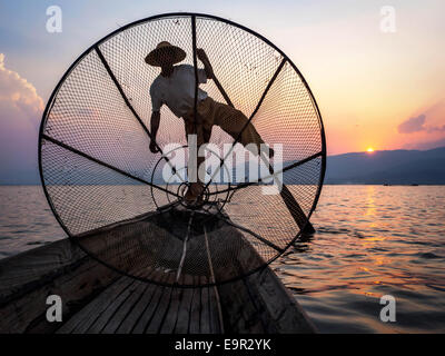 Fisherman in Inle Lake at sunset, Inle, Shan State, Myanmar - Stock Photo