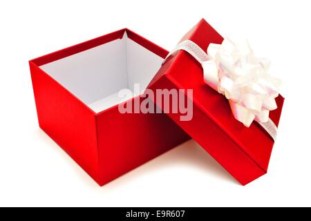 Opened red Christmas gift box with white bow and ribbon - Stock Photo