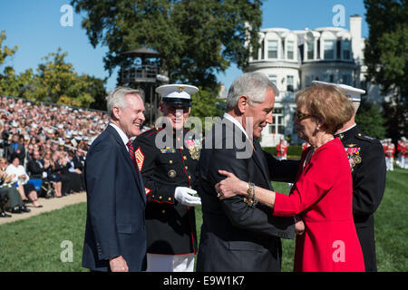 Secretary of Defense Chuck Hagel, left foreground, speaks with Bonnie Amos, the wife of Commandant of the Marine - Stock Photo