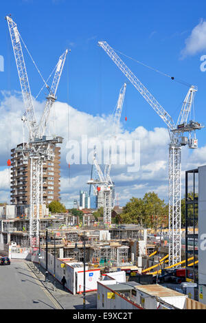 Cranes on Elephant and Castle regeneration project construction site after demolition of Heygate Estate Southwark - Stock Photo