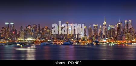 Panoramic view on Manhattan at night - Stock Photo
