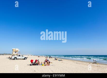 Family on the beach at Huntington Beach State Park, Huntington Beach, Orange County, California, USA - Stock Photo