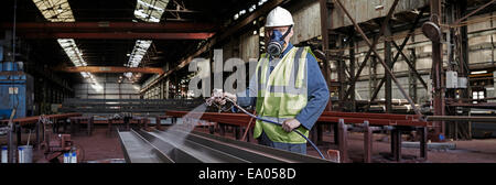 Portrait of a steelworker in his working environment - Stock Photo