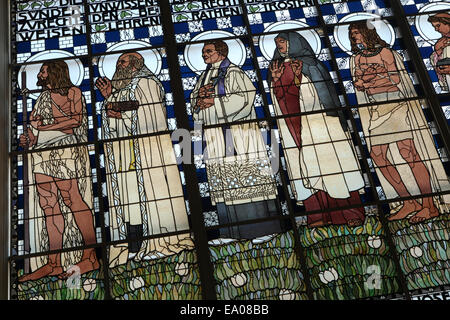 Stained glass window 'The Seven Spiritual Works of Mercy' designed by Austrian artist Koloman Moser (1907) in the - Stock Photo